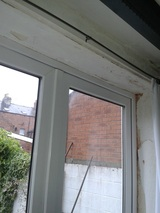 Very bad mastic joint at top of French doors